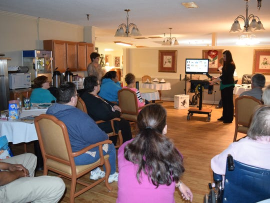 Residents listen in as Molly Rau of iN2L explains the