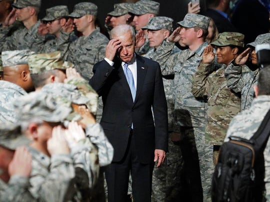 Vice President Joseph R. Biden Jr. is saluted by the Delaware National Guard as he enter the Chase Center on the Riverfront Friday afternoon for a welcome back to Wilmington rally.