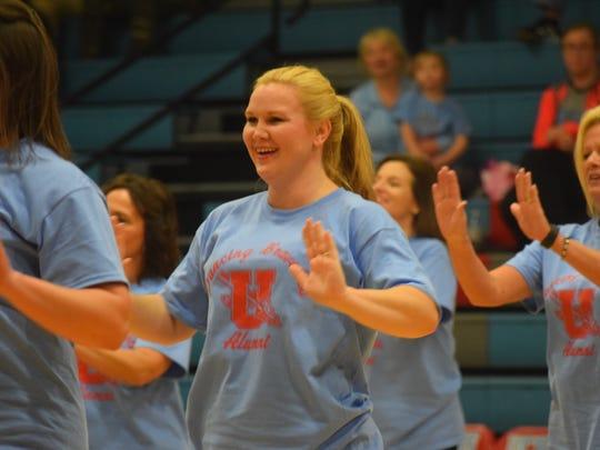 Tara Smith, coach of the Dancing Bravettes dances during the alumni dance.