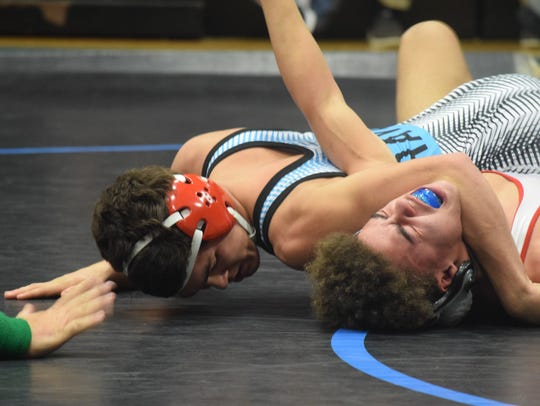 Saul Ervin pins his opponent Saturday morning. This
