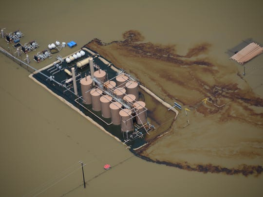 Oil hemorrhages from a production site during June 2015 flooding on the Trinity River.