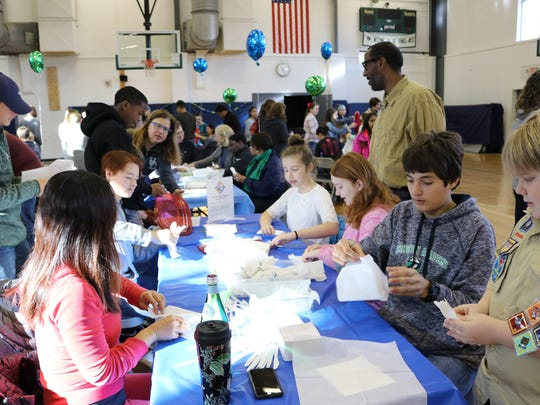Students, parents and friends of Princeton Academy of the Sacred Heart and Stuart Country Day School gathered to participate in community service projects to help local organizations on MLK Day