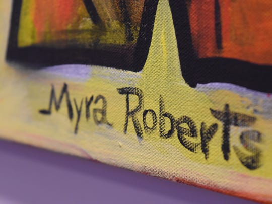 Myra Roberts paintings are displayed inside Hodges University's community room. The gallery display is available to the public until March.