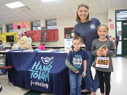 Janelle (middle) Grayson (left) and Kate (right) represent the Hang Tough Foundation at the Trent Trot on Saturday.