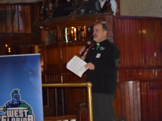 UWF coach Pete Shinnick addresses his team's signing class during a celebration party Wednesday at Seville Quarter