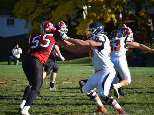 Millbrook native Allan Rappleyea, right, blocks for the Milton Academy football team in a game against Governor's Academy in Massachusetts last November.