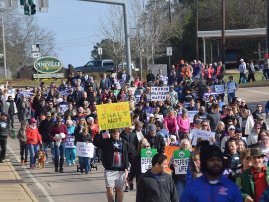 Participants in the Louisiana Life March held Saturday. The walk started at Louisiana College and ended at the amphitheater in downtown Alexandria where guest speakers  included La. attorney general Jeff Landry and U.S. Rep. Ralph Abraham.