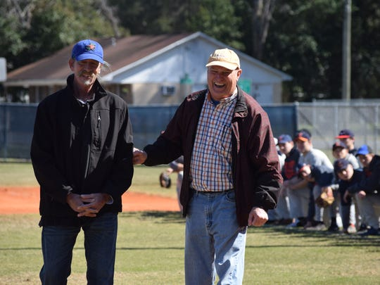 Former Atlanta Braves pitcher Preston Hanna (left) and his high school teammate Ed Moch share a laugh Saturday during ceremony at Escambia High baseball stadium to honor the school's 1972 and 1974 state championships teams that both men were part of producing.