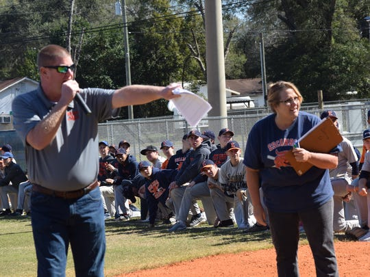 New Escambia HIgh athletic director Ryan James and long-time data specialist and athletic department volunteer Tammy Kirkland directed a reunion Saturday of the school's 1972 and 1974 state championship baseball teams.