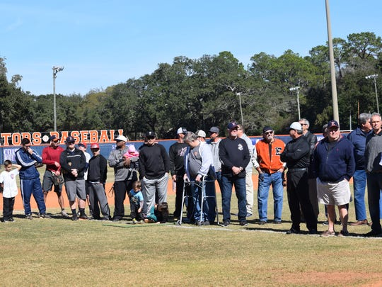 Members of Escambia High's 1972 and 74 state championship baseball teams gather during a ceremony Saturday at their former field to honor the acheivements.