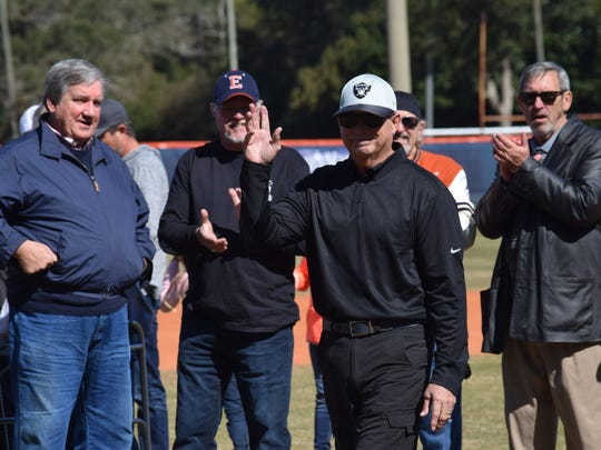 Former star player Kevin Morrell, who remains the state's all-time leader for most stolen bases in a season (47) waves to crowd after being honored Saturday as part Escambia High's reunion of the 1972 and 74 state championshp teams.