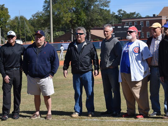 Members of the 1972 and '74 Escambia High baseball team were honored at reunion ceremony Saturday. Left to right: Kevin Morrell, Steve McGowen, Pau Anderson, Steve Howell, Jimmy Brittain, Ed Moch and Preston Hanna.