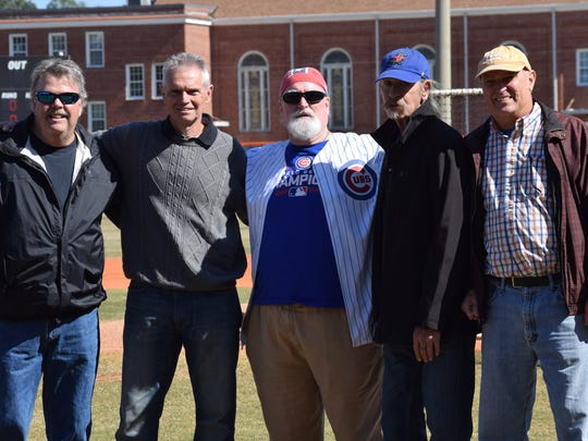 Former Atlanta Braves pitcher Preston Hanna (blue hat) with Escambia High eammates from 1972 state championship team during ceremony Saturday honoring them.  Left to right, Paul Anderson, Steve Howell, JImmy Brittain, Preston Hanna and Ed Moch.