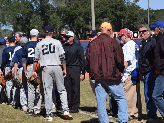 Current members of the Escambia High baseball team greet their predecessors Saturday during reunion of Gators; 1972, and 1974 state championship baseball teams