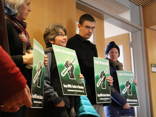 University of Vermont Professors stand outside the negotiating room on Monday, Feb. 6, 2017.