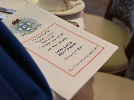 A brochure sits at every table during an annual luncheon