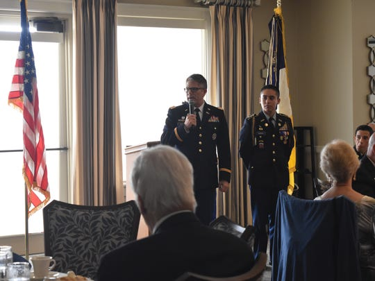 Naples High School JROTC Instructor Paul Garrah speaks