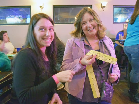 Riane Bernard of Rosenhayn sells raffle tickets to