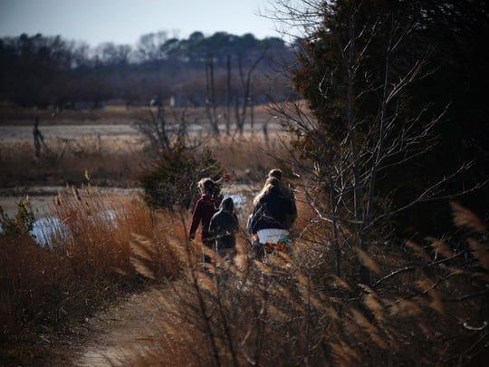 Visitors to Prime Hook National Wildlife Refuge hike along the trails.
