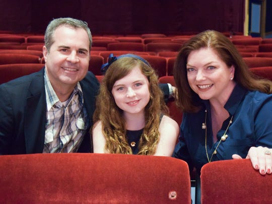 "Ten-year-old Liza Jayne Longenhagen (center) with her parents at Florida Repertory Theatre. Liza stars as Scout in Florida Rep's ""To Kill a Mockingbird."" It's the same theater where parents Greg Longenhagen and Liz Abbott acted before she was born."