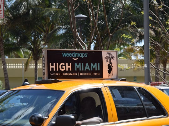 A taxi in Miami displays an advertisement for weedmaps.com, a search tool for marijuana dispensaries and clinics that is new to Florida.