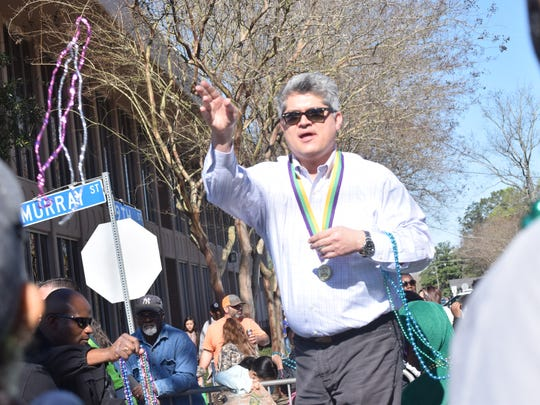 Alexandria Mayor Jacques Roy tosses throws to the crowd during the 2017 Children's Mardi Gras Parade.