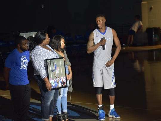 UWF senior forward Deangelo Legrier praises his mother during post-game ceremony Saturday honoring Argos seniors following team's win against Shorter.