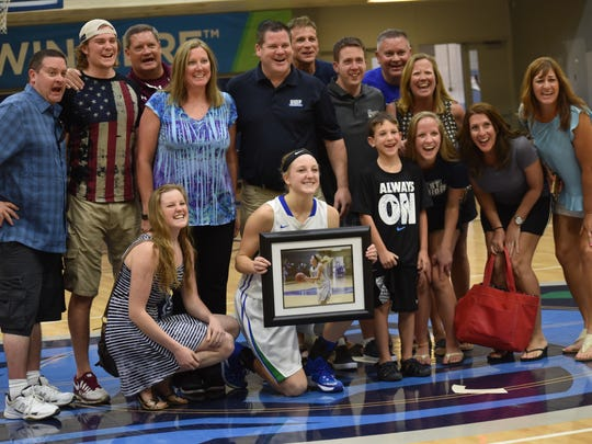 UWF senior forward Katie Bobos is joined by her family and friends after being honored Saturday on senior day in the UWF women's basketball team's final regular season home game.