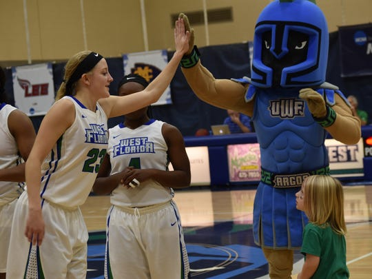 UWF's Katie Bobos celebrates with team mascot and young