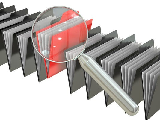 File search concept: folders and magnifying glass, 3D rendering