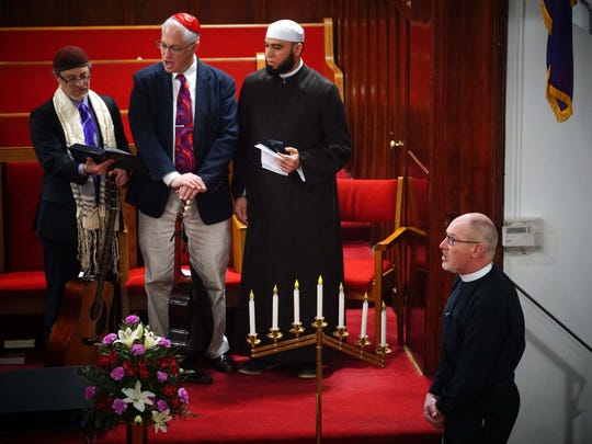 From left, Rabbi Micah Becker-Klein of Temple Beth El, Rabbi Michael Beals of Congregation Beth Shalom and Imam Abdul Hadi Shehata of the Islamic Society of Delaware and the Rev. Doug Gerdts of First and Central Presbyterian Church sing a song during an interfaith prayer gathering Wednesday at Bethel African Methodist Episcopal Church in Wilmington.