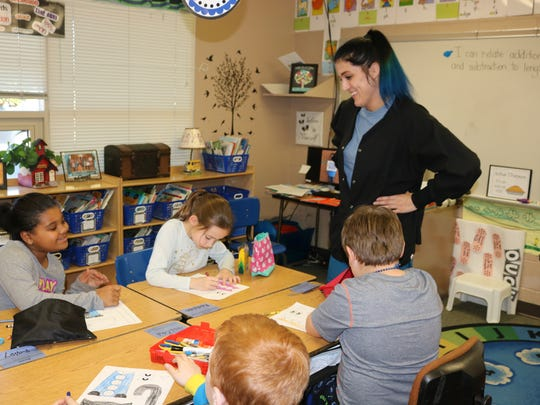 In this file photo, Job Corps student Rebekah Moore talks to children during a reading project. The U.S. Department of Labor will award up to 20 grants to institutions such as community colleges  to serve Job Corps-eligible youths.