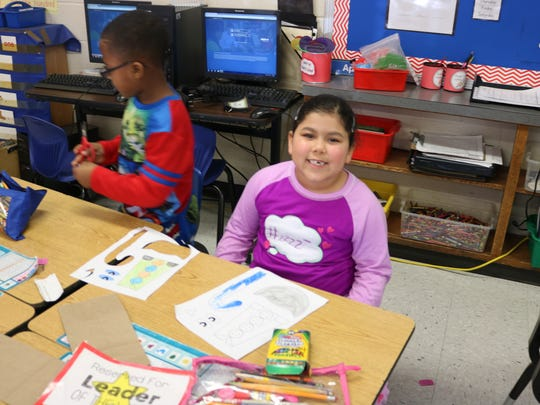 MES student Nia Morris happily participated in the Read to Lead activities on Thursday morning.