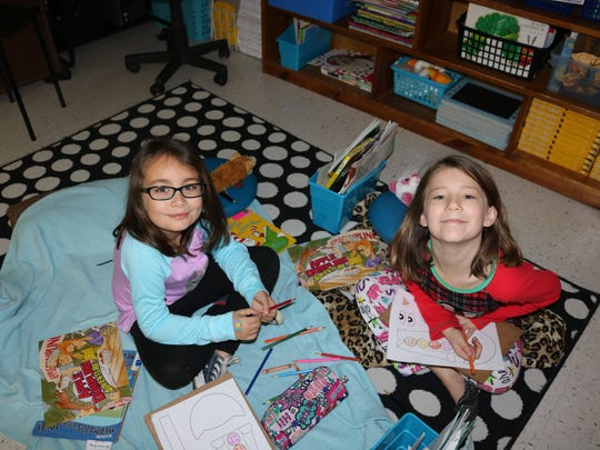 Nanett Mattingly (left) and Keira Holmes (right) enjoy activities and books during the Read to Lead session.