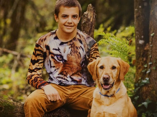 Cam Johnson and the family's beloved dog Murray were inseparable, including when it came time for senior pictures.