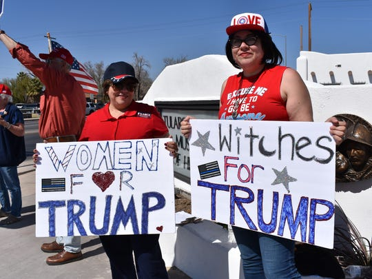 Alma Williams and Nova Perez, a mother-daughter duo from El Paso, hold signs in support of President Donald Trump on Saturday afternoon.