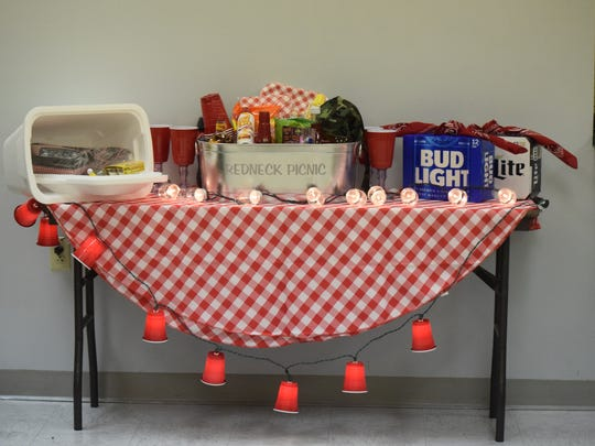 "A ""Redneck Picnic Basket"" was one of the items available to bid on that was donated by the John Paul II 8th grade class."