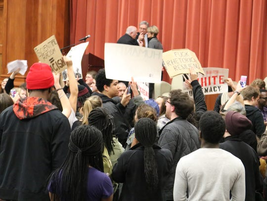 Middlebury College students chant as Professor Allison