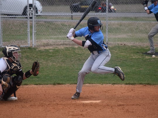 Union County's Trey Hutchison takes a swing at a pitch.