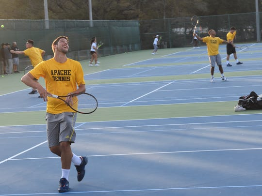 Members of the Tyler Junior College men's tennis team from Tyler, Texas, go through practice Thursday at Roger Scott Tennis Center following their 10-hour bus trip. The Apaches play in the Pensacola Collegiate Tennis Invitational this weekend.