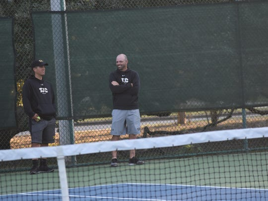 Tyler Junior College tennis coach Dash Connell (right) and assistant coach Kimm Ketelson watch the Apaches' men's and women's teams go through a practice Thursday at Roger Scott Tennis Center.