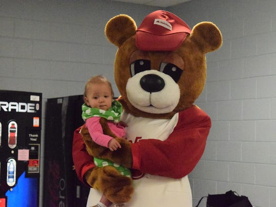Madeline Pierce receives some cuddles from the State Farm bear.