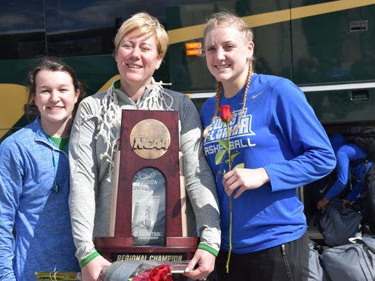 Senior stars Alex Coyne (left) and Katie Bobos join UWF coach Stephanie Lawrence Yelton after arriving back to campus Tuesday with the NCAA South Region Championship trophy. It's the first time UWF has reached this level in the NCAA tournament.