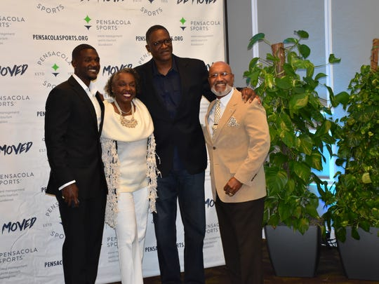 From left: Olympic sprint champion Justin Gatlin, his mother Jeanette, NBA Hall of Famer Dominique Wilkins and Gatlin's father Willie pose for photos at the 63rd Annual Pensacola Sports Awards Banquet on March 15, 2017.