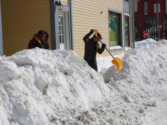 Burlington residents dig out, again and again.. and