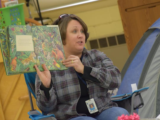 "Jaime Keller, elementary principal of Shalom Christian Academy, reads 'The Great Kapok Tree,"" by Lynne Cherry to fifth-graders on Wednesday."