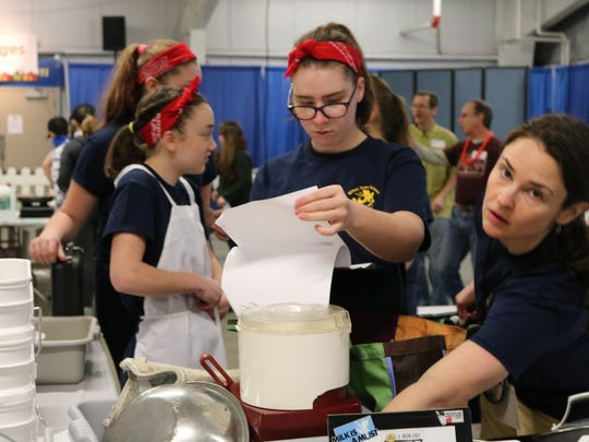 The Milton Middle School Allspice Girls set up their station as the competition begins at the Jr. Iron Chef Vermont competition at the Champlain Valley Exposition center in Essex Junction on March 18, 2017.