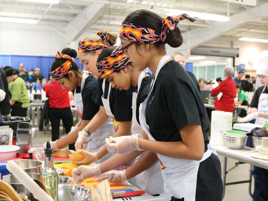 The Tuttle Middle School Rising Flames work seamlessly together on their butternut squash pasta dish on March 18, 2017 at the Jr. Iron Chef Vermont competition.