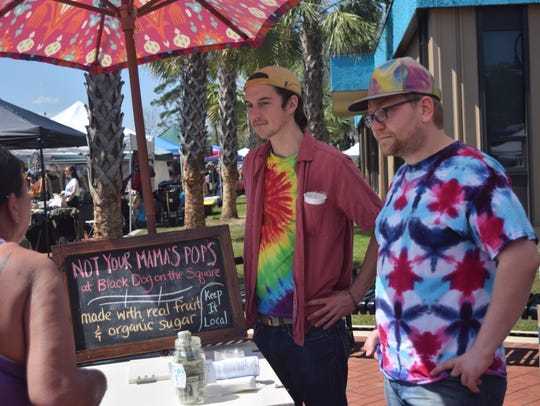 rrest Kluson, left, and Emile Boghos, right, talk with Susie McFarland at Not Your Mama's Pops at a previous North Florida VegFest