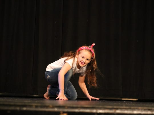 "Laken Buckman crouches down during her dance performace of ""Some Days You Gotta Dance"" by the Dixie Chicks."